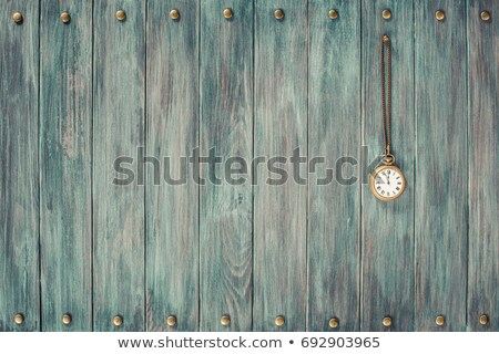 time   vintage pocket watch on weathered wood background stock photo © nessokv