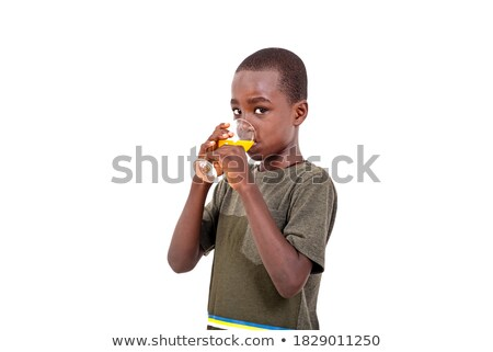 Stock photo: Happy Eight Year Old Boy Looking Sideways