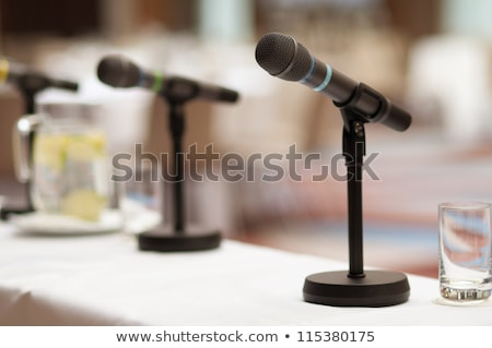Empty conference hall. focus on a screen. rows of chairs in out of focus. Stock photo © Paha_L