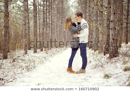 Young Couple Embracing in Winter Forest Stock photo © dariazu