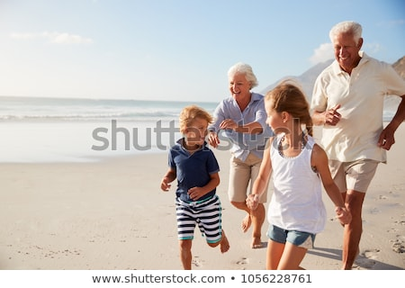 Grandfather with granddaughter run as to beach Stock photo © Paha_L