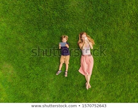 anya · fiú · hazugság · fű · park · ősz - stock fotó © Paha_L