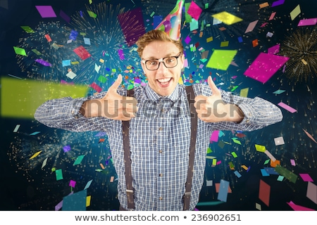 Composite image of happy geeky hipster wearing a party hat Stock photo © wavebreak_media