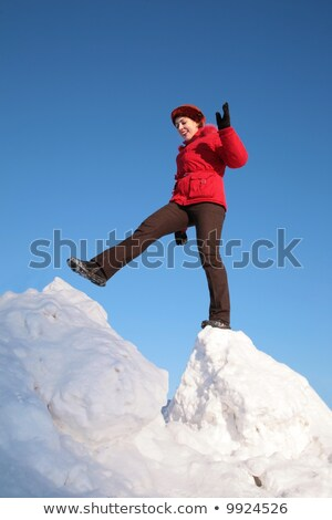 woman steps from one snowy chunk to another Stock photo © Paha_L