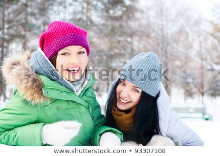 Two young woman chatting outdoors in winter Stock photo © dash
