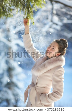 The portrait of beautiful, attractive, cheerful girl, woman, model in the green fir-trees and spruce Stock photo © ANessiR