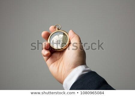 Businessman Holding Compass Stock photo © AndreyPopov