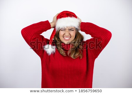 desperate pretty woman with hands on head suffering from headache stock photo © deandrobot