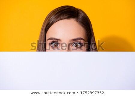 Komik genç kadın gizleme arkasında gri Stok fotoğraf © deandrobot