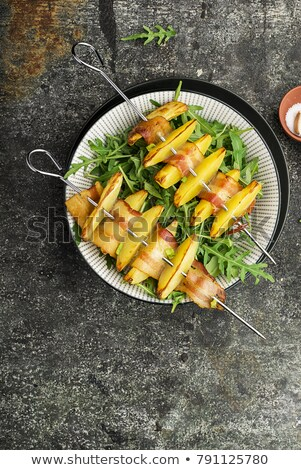 Bacon and potato skewer with salad greens stock photo © Digifoodstock