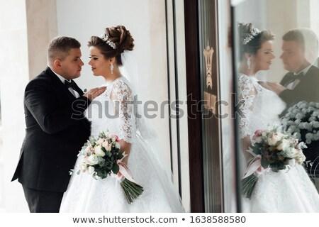 Stylish Newlywed Groom and Bride Standing Together  Stock photo © dariazu