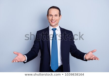 smiling young business man in suit and tie welcoming you Stock photo © feedough