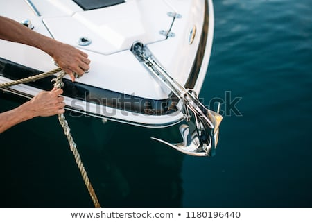 Sailor man in his motor boat Stock photo © deandrobot