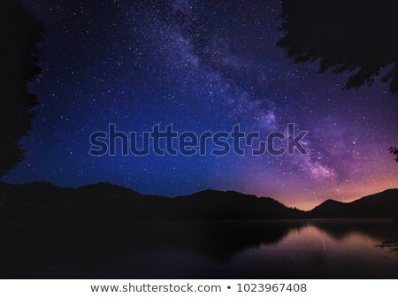Stock photo: Night landscape with a mountain lake and a starry sky