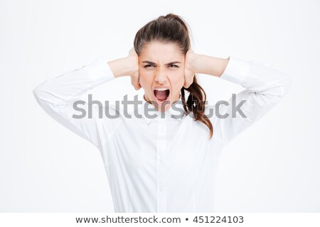 Attractive businesswoman covering ears with her hands Stock photo © williv