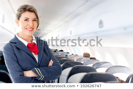 Young attractive air hostess smiling Stock photo © Aikon