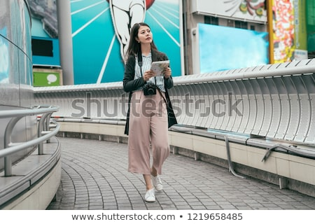 young man walking by the center line of a road Stock photo © nito