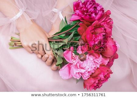 Stock photo: Beautiful girl with peony flower