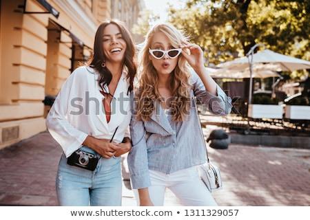 Kettő divatos lányok pózol fiatal gyönyörű Stock fotó © NeonShot