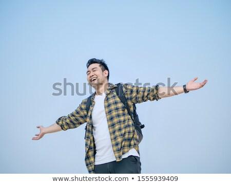 幸せ 男 腕 笑みを浮かべて 水色 デジタル複合 ストックフォト © wavebreak_media