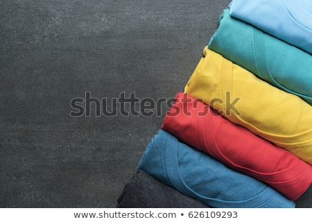 pile of colorful t shirts freshly folded from the laundry stock photo © kayros