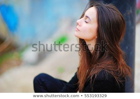 peaceful business woman meditating in lotus pose stock photo © rastudio