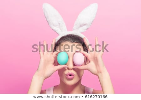 Jolie femme œufs de Pâques isolé blanche heureux Photo stock © mmarcol