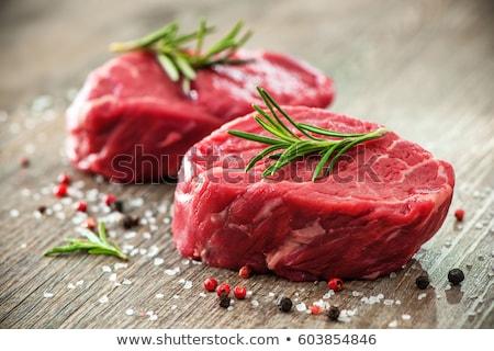 Raw meat, fillet, tenderloin on wooden background Stock photo © yelenayemchuk