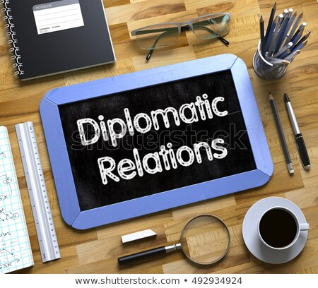 Small Chalkboard with Diplomatic Relations Concept. 3D. Stock photo © tashatuvango