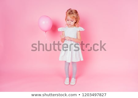 5 years old girl holding a balloon stock photo © is2