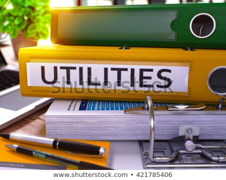 Utilities on Yellow Office Folder. Toned Image. Stock photo © tashatuvango