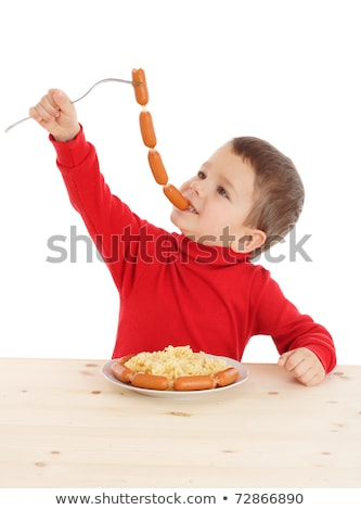 Hand holding sausages chain stock photo © digitalr