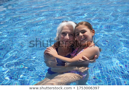Сток-фото: Young Woman And Child By Pool