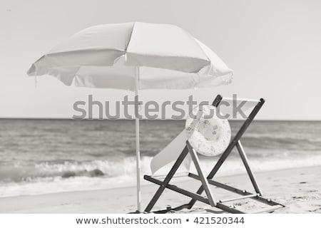összehajtva fedélzet székek homokos tengerpart vízpart befejezés Stock fotó © stevanovicigor