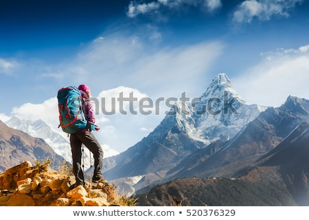 Woman backpacker climbing with backpack in Himalayas, Nepal Stock photo © blasbike