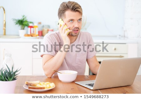 businessman reading whilst eating stock photo © is2