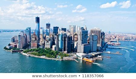 Kilátás Manhattan felhők víz épület kék Stock fotó © vwalakte
