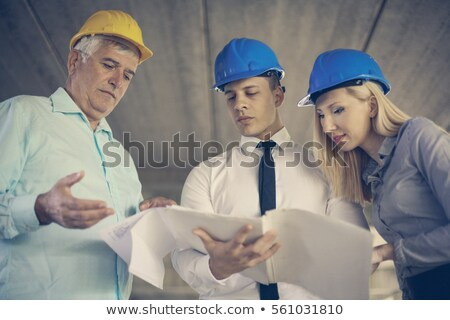 Woman reading blueprints outdoors Stock photo © IS2