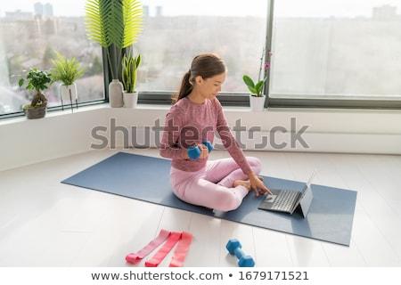 Girl Multitasking Remote Dumbbell Stock photo © lenm