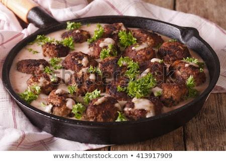 Rusztikus húsgombócok serpenyő közelkép hús marhahús Stock fotó © zkruger