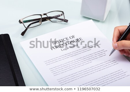 Woman Holding Pen Over Notice Of Foreclosure Document Stock photo © AndreyPopov