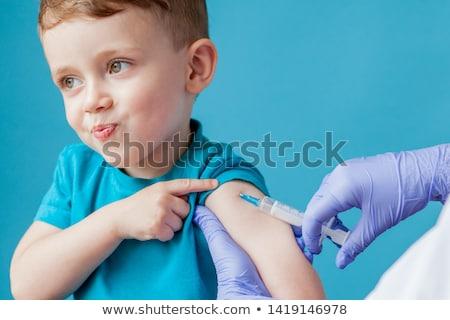 Vacinação criança médico menina mão Foto stock © choreograph