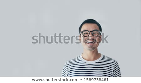 moço · óculos · de · sol · em · pé · cinza · parede - foto stock © feedough