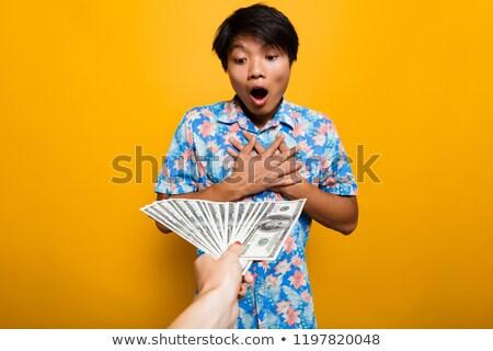 Meglepett ázsiai férfi pénz bankjegyek izolált Stock fotó © deandrobot