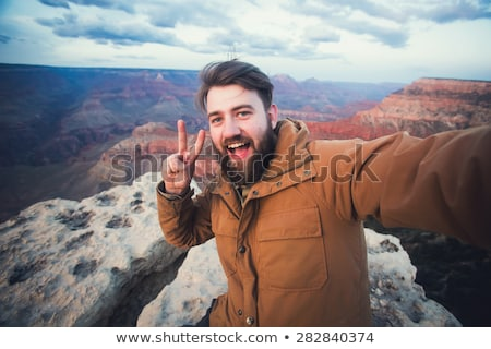 happy travelers taking selfie at grand canyon Stock photo © dolgachov