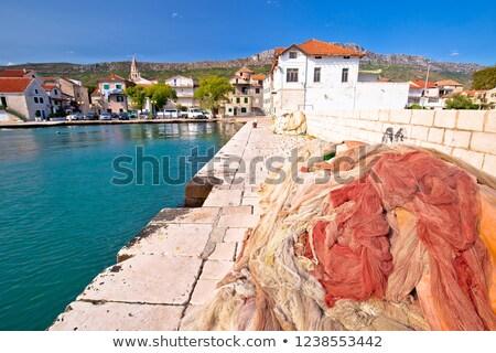 Fishing nets on dock in adriatic village of Kastel Kambelovac Stock photo © xbrchx