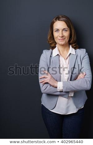 elderly woman on studio dark gray background Stock photo © Lopolo