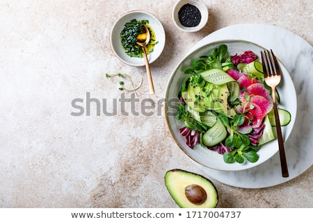 Pink radish sprouts in a bowl on white background stock photo © madeleine_steinbach