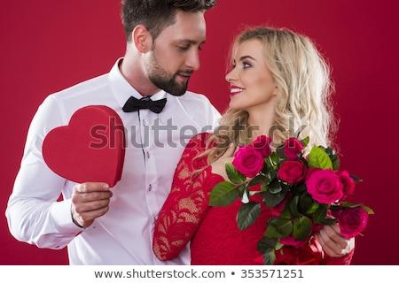 Nő vörös ruha megérint elegáns mellkas szürke Stock fotó © feedough
