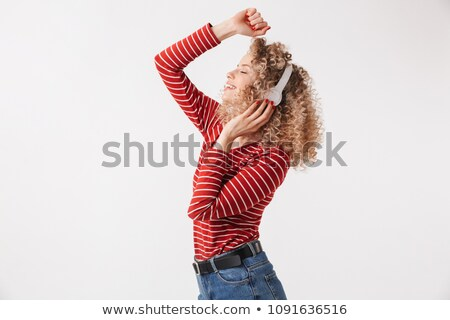 Side view of cheerful blonde curly woman in casual clothes Stock photo © deandrobot